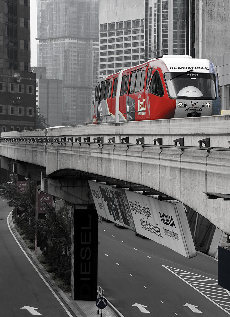 A selectively colored monorail car in downtown. - Kuala Lumpur, Malaysia - Daily Travel Photos