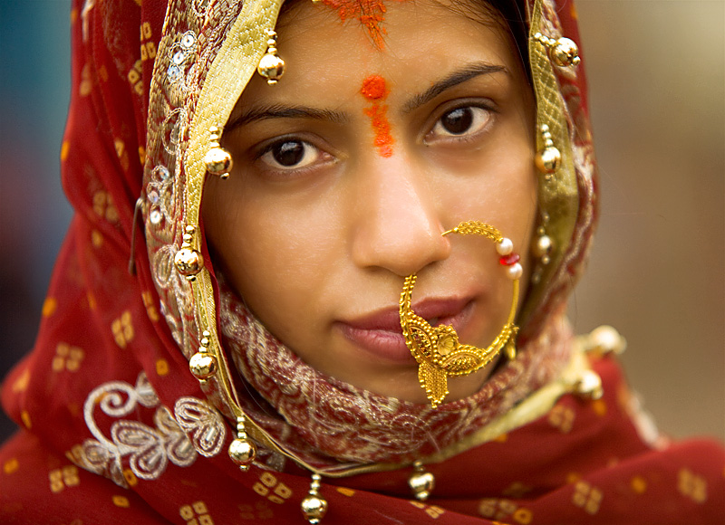 A stunningly beautiful Indian woman poses for a portrait on the Ganges river. - Varanasi, Uttar Pradesh, India - Daily Travel Photos