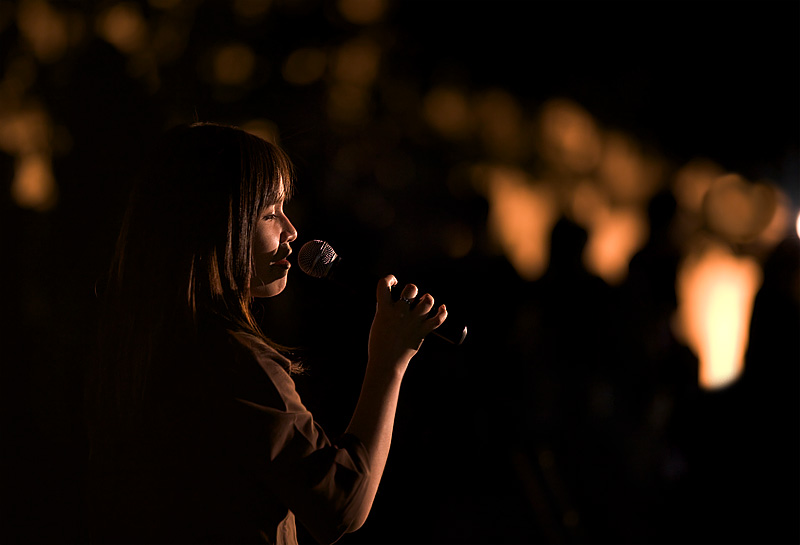 An amateur female singer at an outdoor concert. - Bangkok, Thailand - Daily Travel Photos