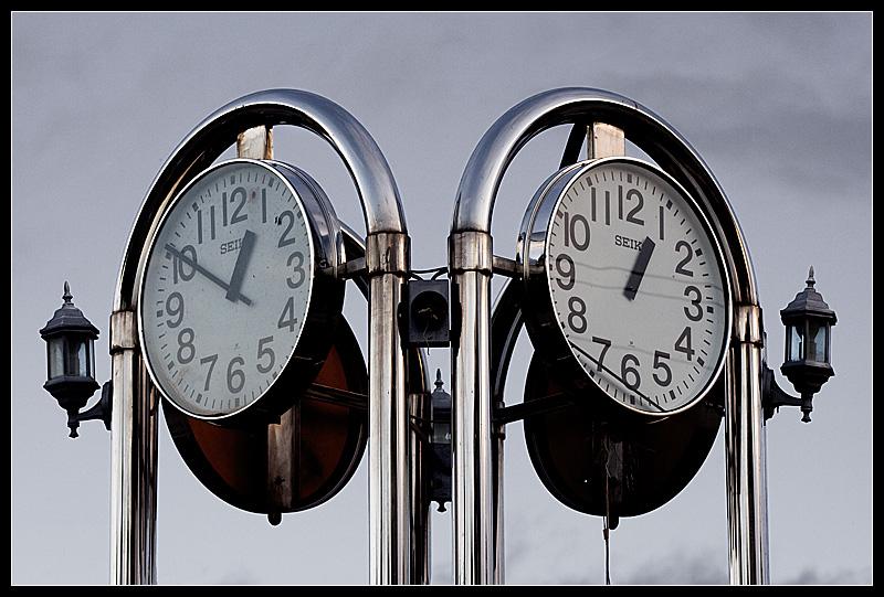 Broken public clocks against the sky. - Dili, East Timor - Daily Travel Photos