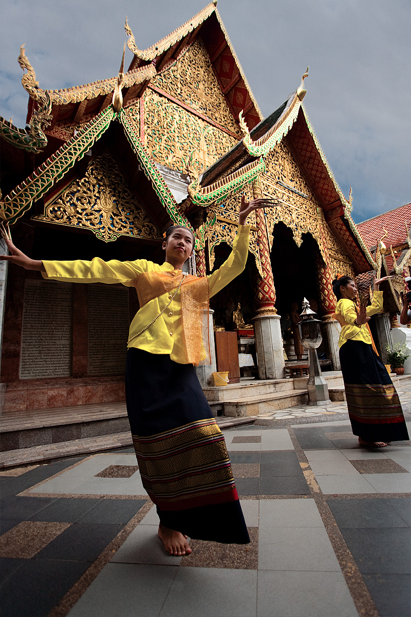 Two young Thai girls perform a traditional dance at Wat Phrathat Doi Suthep. - Chiang Mai Province, Thailand - Daily Travel Photos