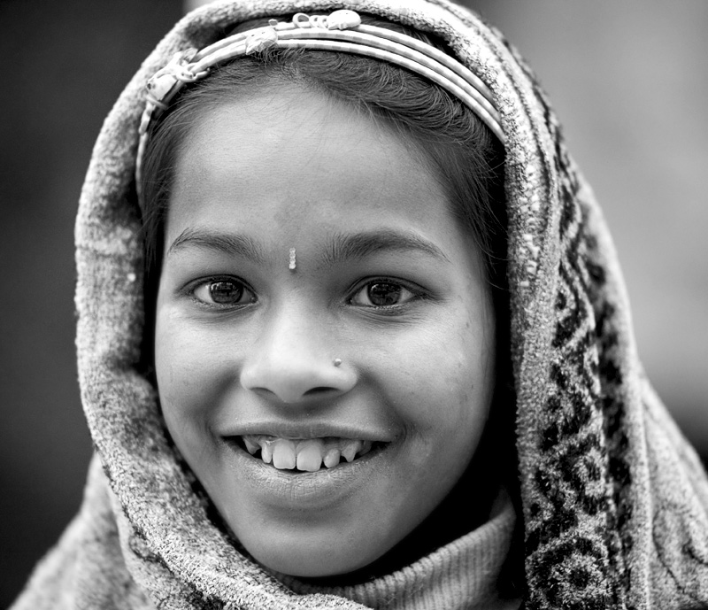 A beautiful young Sikkimese girl wearing a headscarf. - Gangtok, Sikkim, India - Daily Travel Photos