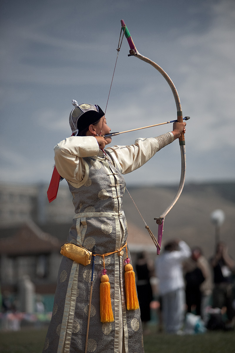 A female archer aims at a target at the Nadaam Festival archery competition. - Ulaan Baatar, Mongolia - Daily Travel Photos