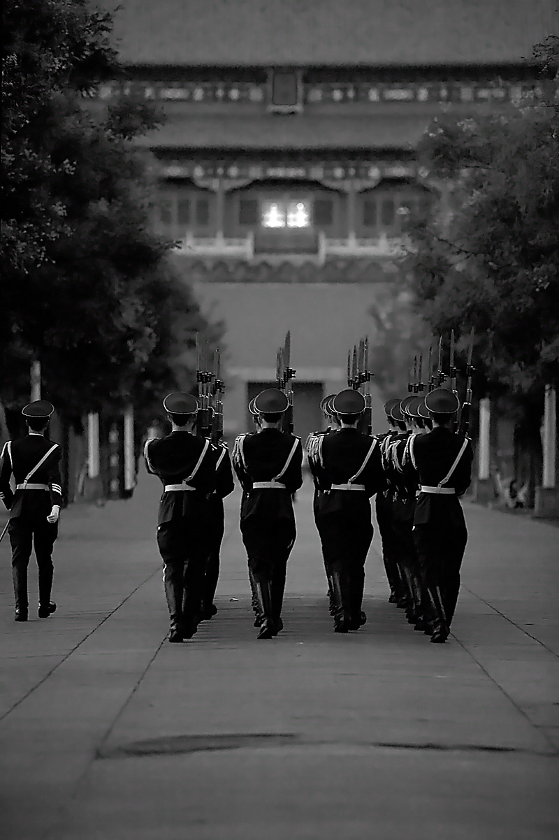 Chinese soldiers march through the Forbidden city after the flag lowering ceremony on Tienanmen Square. - Beijing, China - Daily Travel Photos