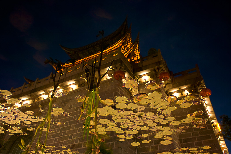 A beautiful water reflection of a temple at night. - Dali, Yunnan, China - Daily Travel Photos