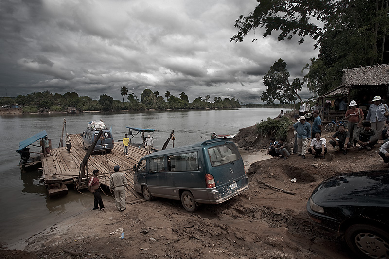 A makeshift raft transports cars over a river crossing. - Sihanoukville, Cambodia - Daily Travel Photos