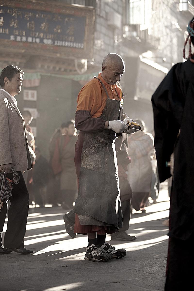 A devout Tibetan Buddhist prostrates himself on the Barkor. - Lhasa, Tibet - Daily Travel Photos