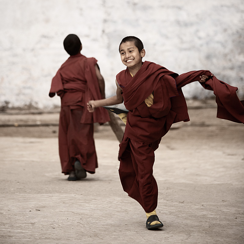 A young monk celebrates a strike out during a cricket match at the Ghoom Monastery. - Darjeeling, West Bengal, India - Daily Travel Photos