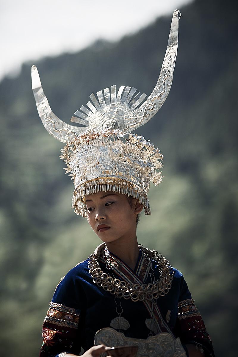Miao minority girls in traditional festival clothes. - Xijiang, Guizhou, China - Daily Travel Photos