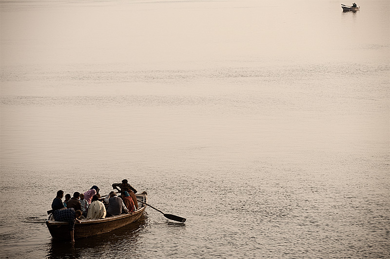 Boat tours on the Ganges row toward each other. - Varanasi, Uttar Pradesh, India - Daily Travel Photos