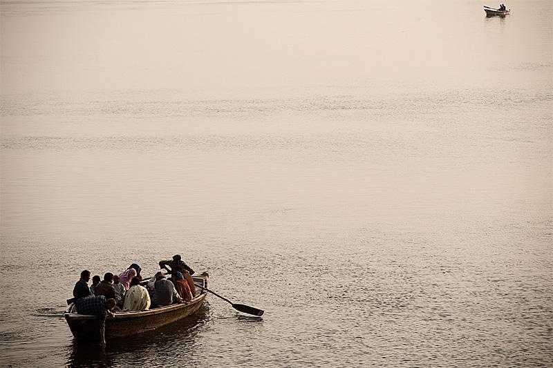Boat tours on the Ganges row toward each other. - Varanasi, Uttar Pradesh, India - Daily Travel Photos