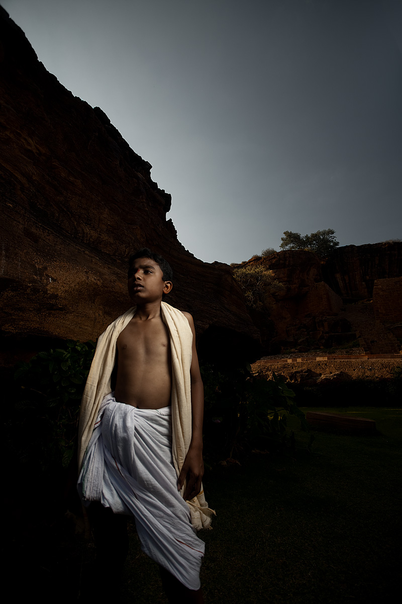 A young Brahman boy among the cliffs (strobist). - Badami, Karnataka, India - Daily Travel Photos