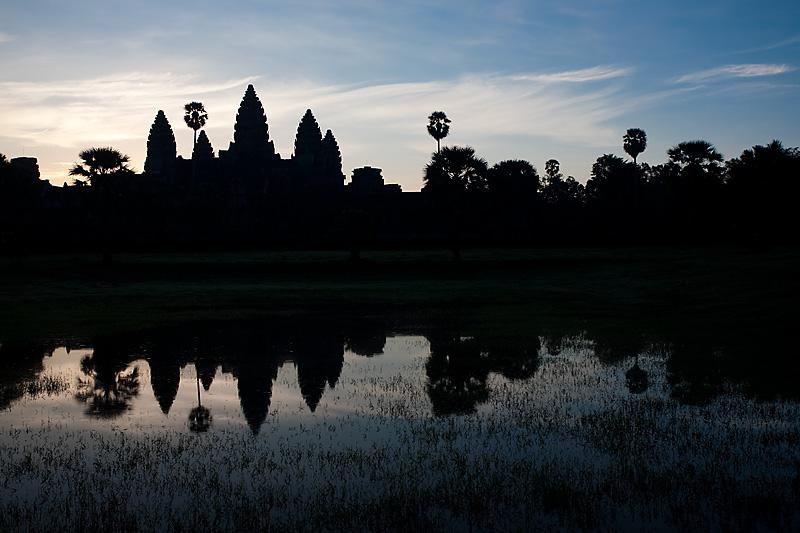 Angkor Wat reflected in a pool of rainwater. - Siem Reap, Cambodia - Daily Travel Photos