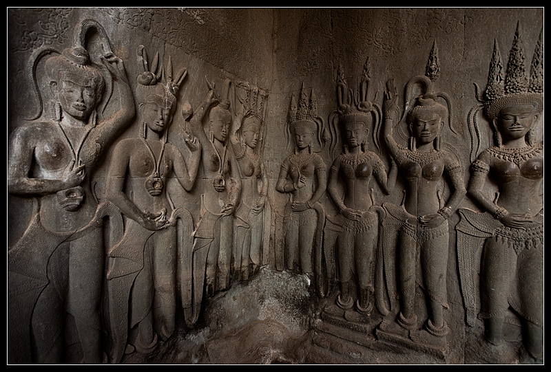 Statues of apsaras damaged by human hands at Angkor Wat. - Siem Reap, Cambodia - Daily Travel Photos