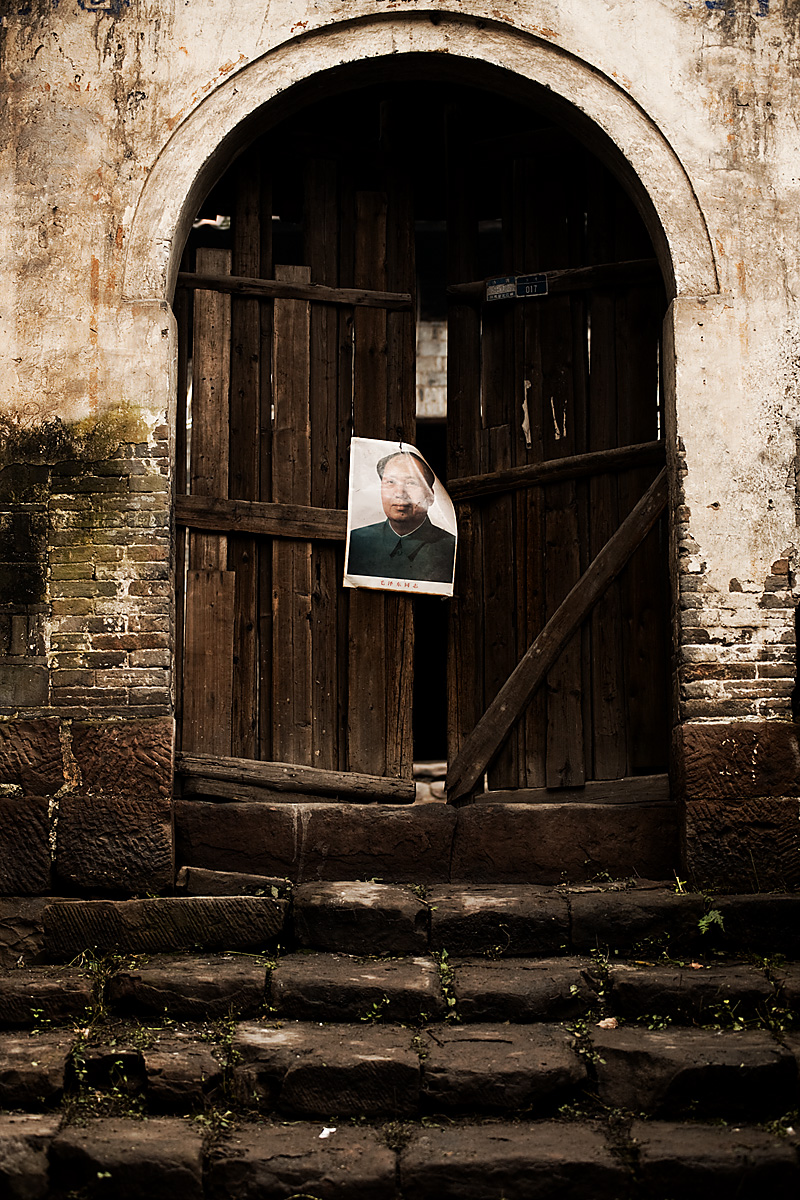Mao's picture nailed to a door. - Fenghuang, Hunan, China - Daily Travel Photos