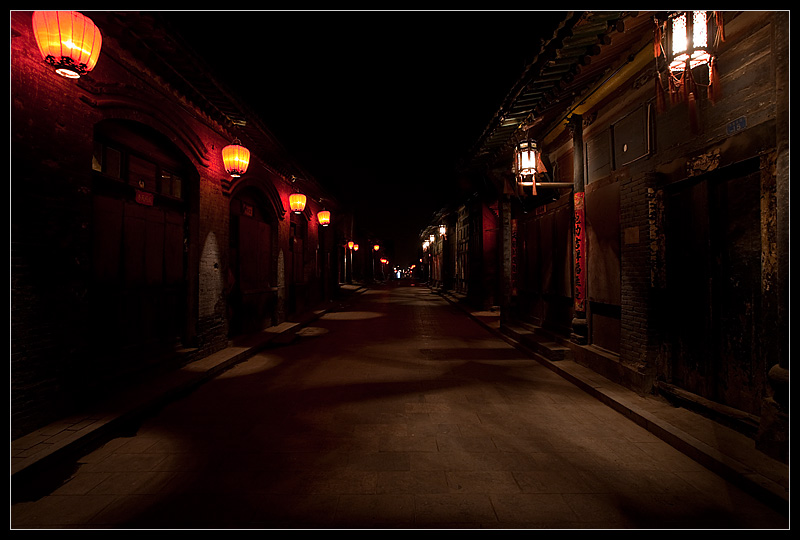 Traditional Chinese red lanterns on a beautiful empty street. - Pingyao, Shanxi, China - Daily Travel Photos