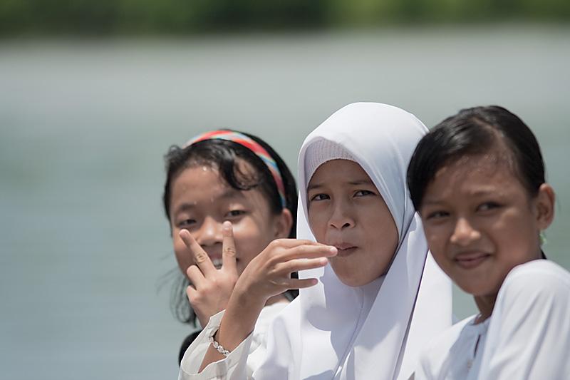 Young Muslim schoolgirls boating to class. - Sungei Kinabatangan, Sabah, Borneo, Malaysia - Daily Travel Photos