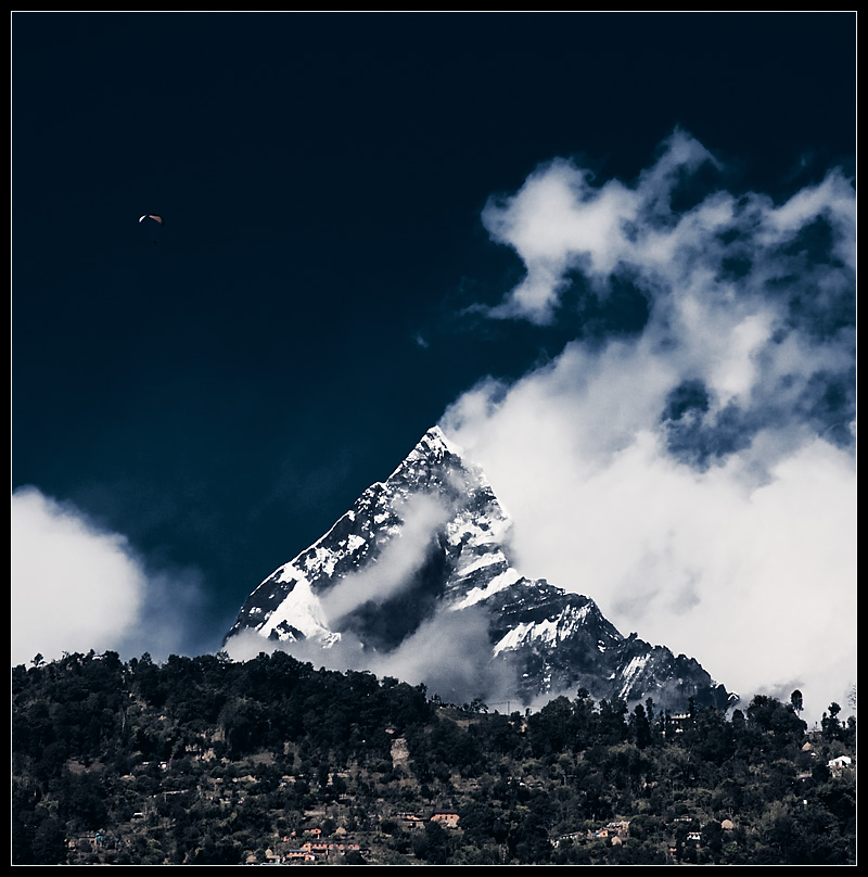 A paraglider and Himalayan mountain, Machapuchre. - Pokara, Nepal - Daily Travel Photos