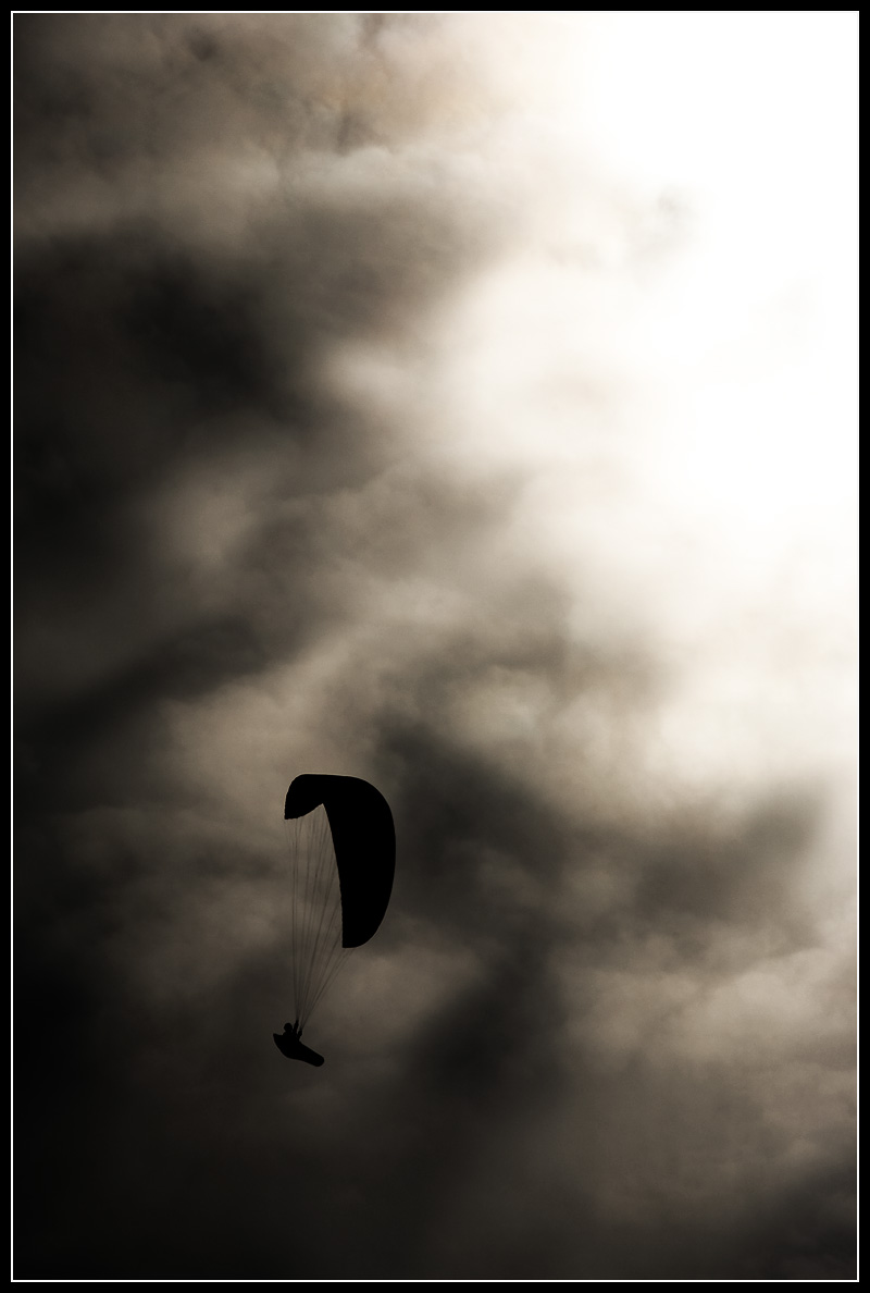 Paraglider enjoying thermals around Machapuchre in the HImalayan Mountains. - Sarangkot, Nepal - Daily Travel Photos