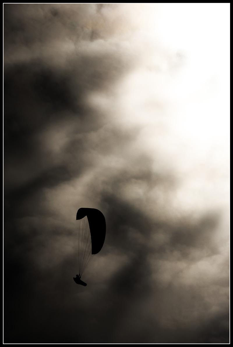 Paraglider enjoying thermals around Machapuchre in the HImalayan Mountains. - Sarangkot, Nepal - Daily Travel Photos