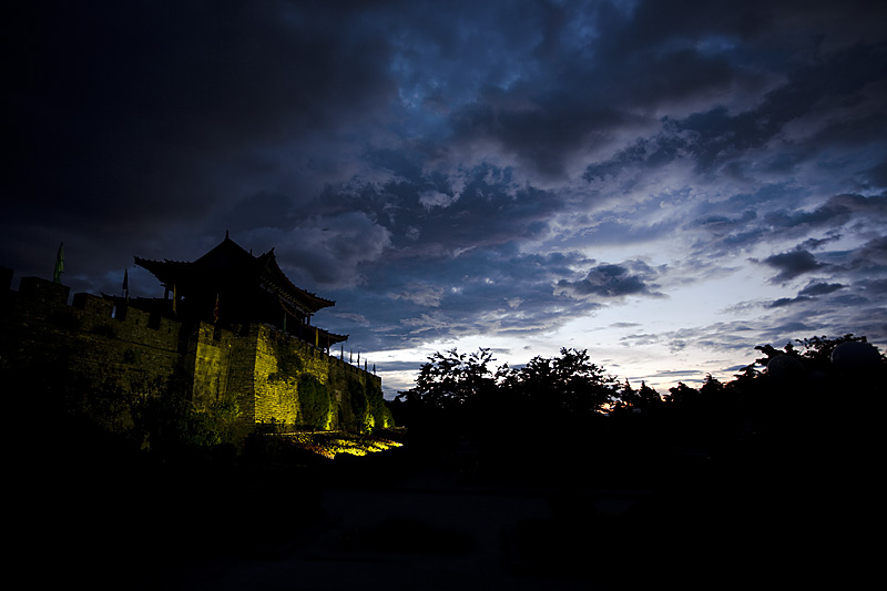 South gate of the old city and moody clouds. - Dali, Yunnan, China - Daily Travel Photos
