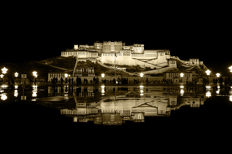 Night water fountain show in front of a reflected Potala Palace - Lhasa, Tibet - Daily Travel Photos