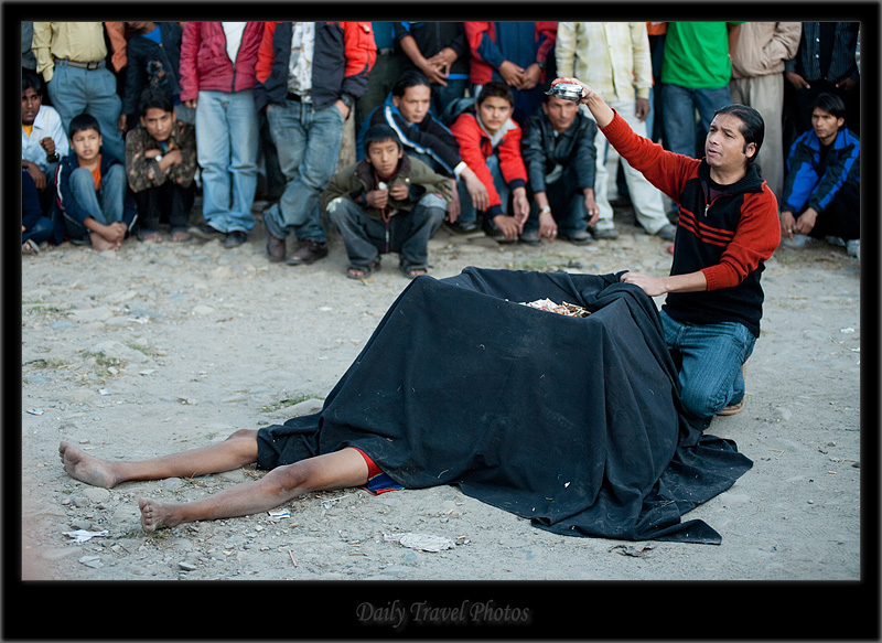Street magician removes blood from a willing participant. - Kathmandu, Nepal - Daily Travel Photos