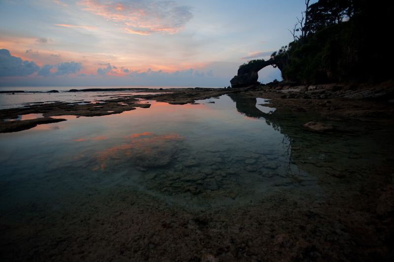 A natural arch reflected in pools of trapped ocean water low-tide at sunset. - Neil Island, Andaman Nicobar Islands, India - Daily Travel Photos