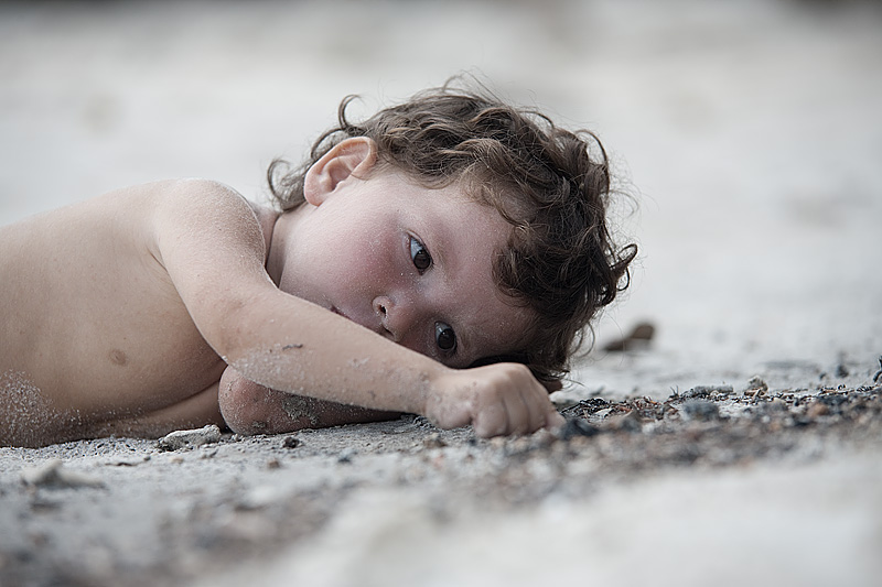A small child plays in the sand of a beautiful Thai island. - Koh Lipeh, Thailand - Daily Travel Photos