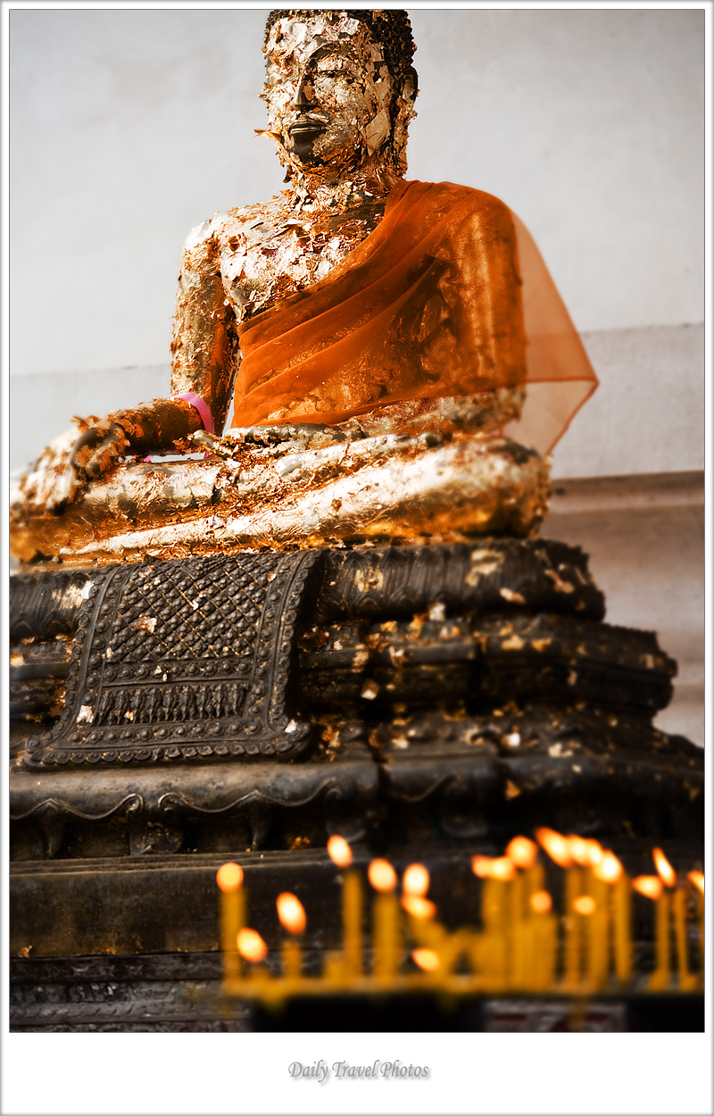 A statue of Buddha covered with gold leaf pieces - Ayuthaya, Thailand - Daily Travel Photos