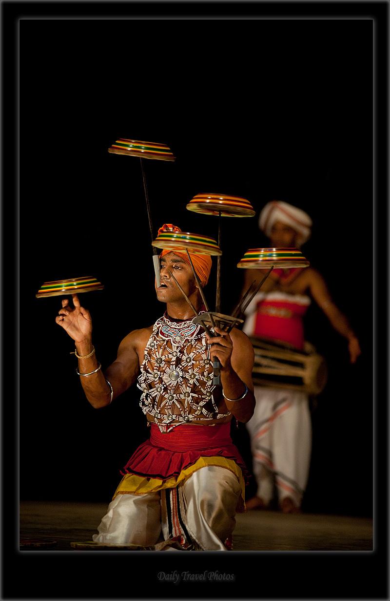 Traditional Sri Lankan plate male spin performer. - Kandy Dance II - Kandy, Sri Lanka - Daily Travel Photos