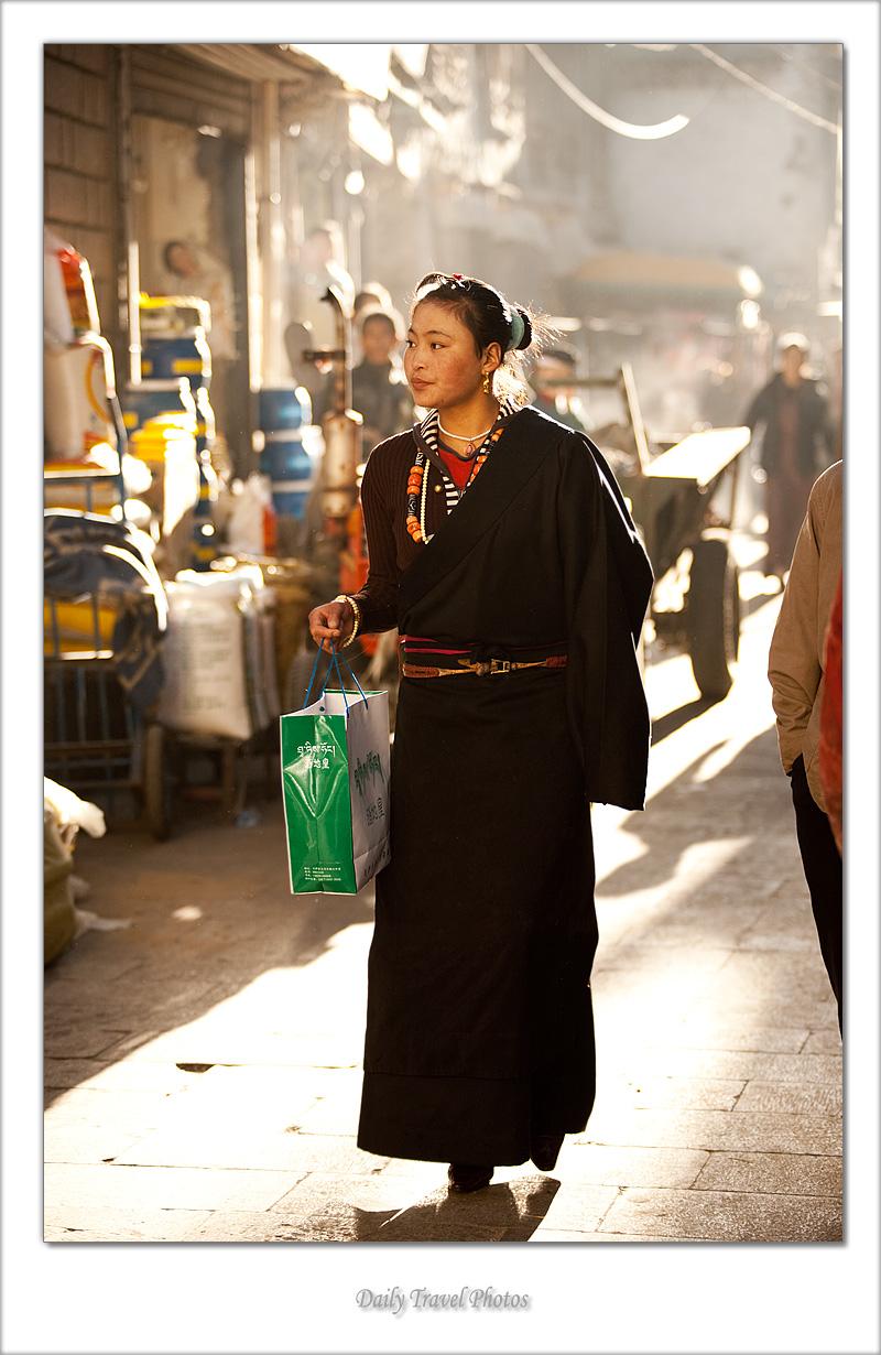 Chic beautiful young Tibetan woman on the Barkhor - Lhasa, Tibet - Daily Travel Photos