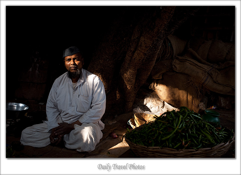 A chili salesman under the shade of a tree - Badami, Karnataka, India - Daily Travel Photos