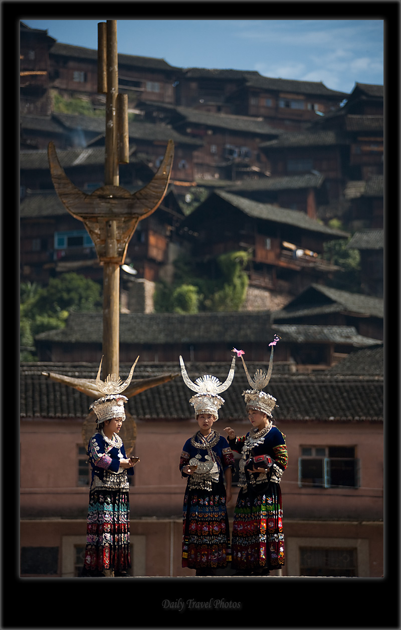 Beautiful young Miao ethnic minority women dressed in traditional clothes - Xijiang, Guizhou, China - Daily Travel Photos