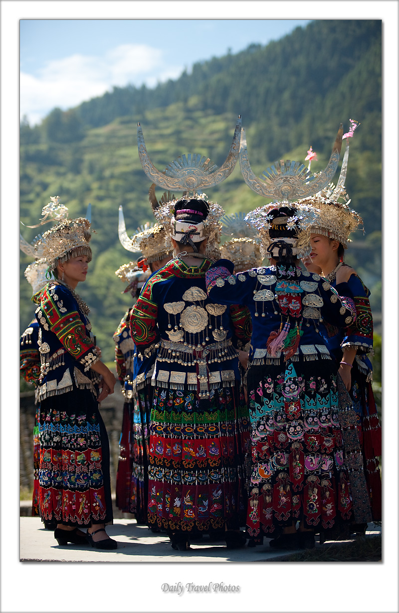 Beautiful young Miao ethnic minority women dressed in ornate traditional costume - Xijiang, Guizhou, China - Daily Travel Photos