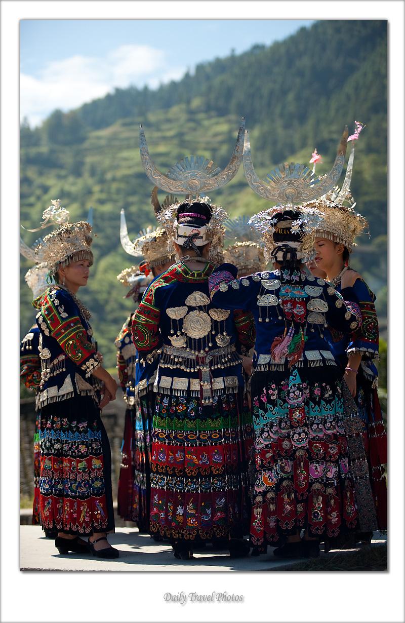 Beautiful young Miao ethnic minority women dressed in ornate traditional costume - Xijiang, Guizhou, China - Daily Travel Photos