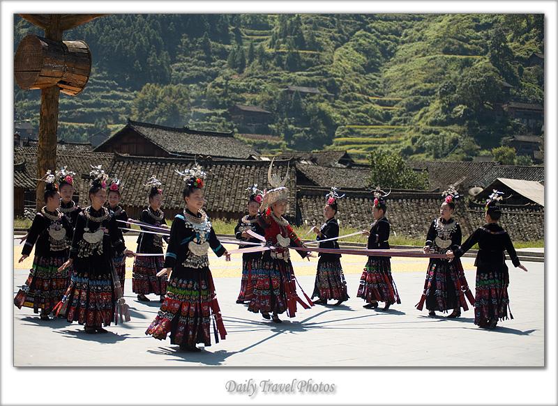 Beautiful young Miao ethnic minority women dance in traditional costume - Xijiang, Guizhou, China - Daily Travel Photos
