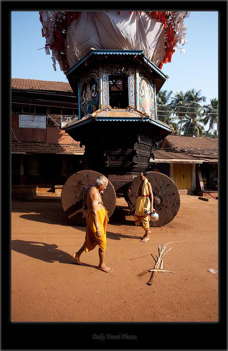 Brahmins pass in front of a ratha chariot meant for full moon festivities - Gokarna, Karnataka, India - Daily Travel Photos