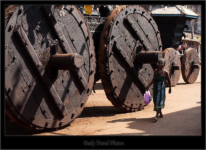An old woman passes in front of a ratha chariot - Gokarna, Karnataka, India - Daily Travel Photos