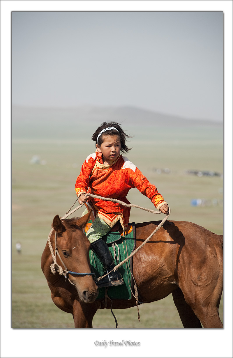 A young Mongolian girl turns on horseback - Ulaan Baatar, Mongolia - Daily Travel Photos