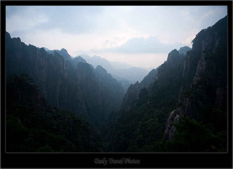 Misty valley of a mountain range - Huangshan, Zhejiang, China - Daily Travel Photos