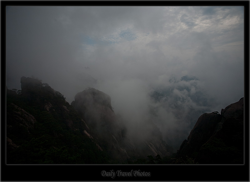 Misty peaks of a mountain range - Huangshan, Zhejiang, China - Daily Travel Photos