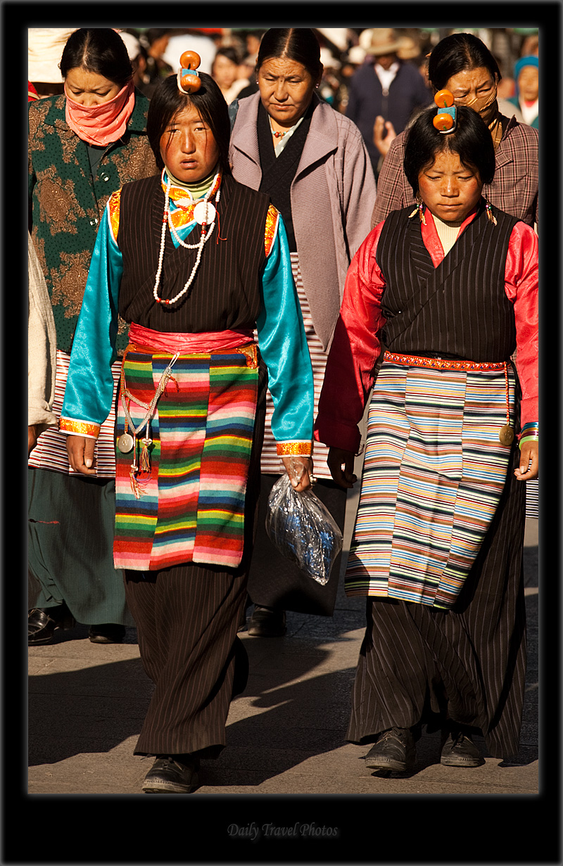 An ornately decorated hair piece on a Tibetan woman - Lhasa, Tibet - Daily Travel Photos