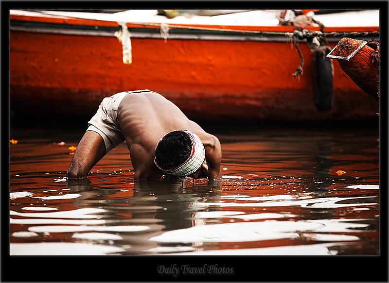 An Indian man dredges for coins in the Ganges - Varanasi, Uttar Pradesh, India - Daily Travel Photos