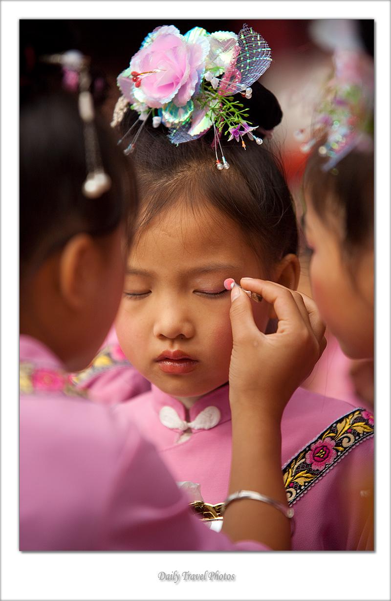 Young ethnic minority Miao girls apply makeup - Xijiang, Guizhou, China - Daily Travel Photos
