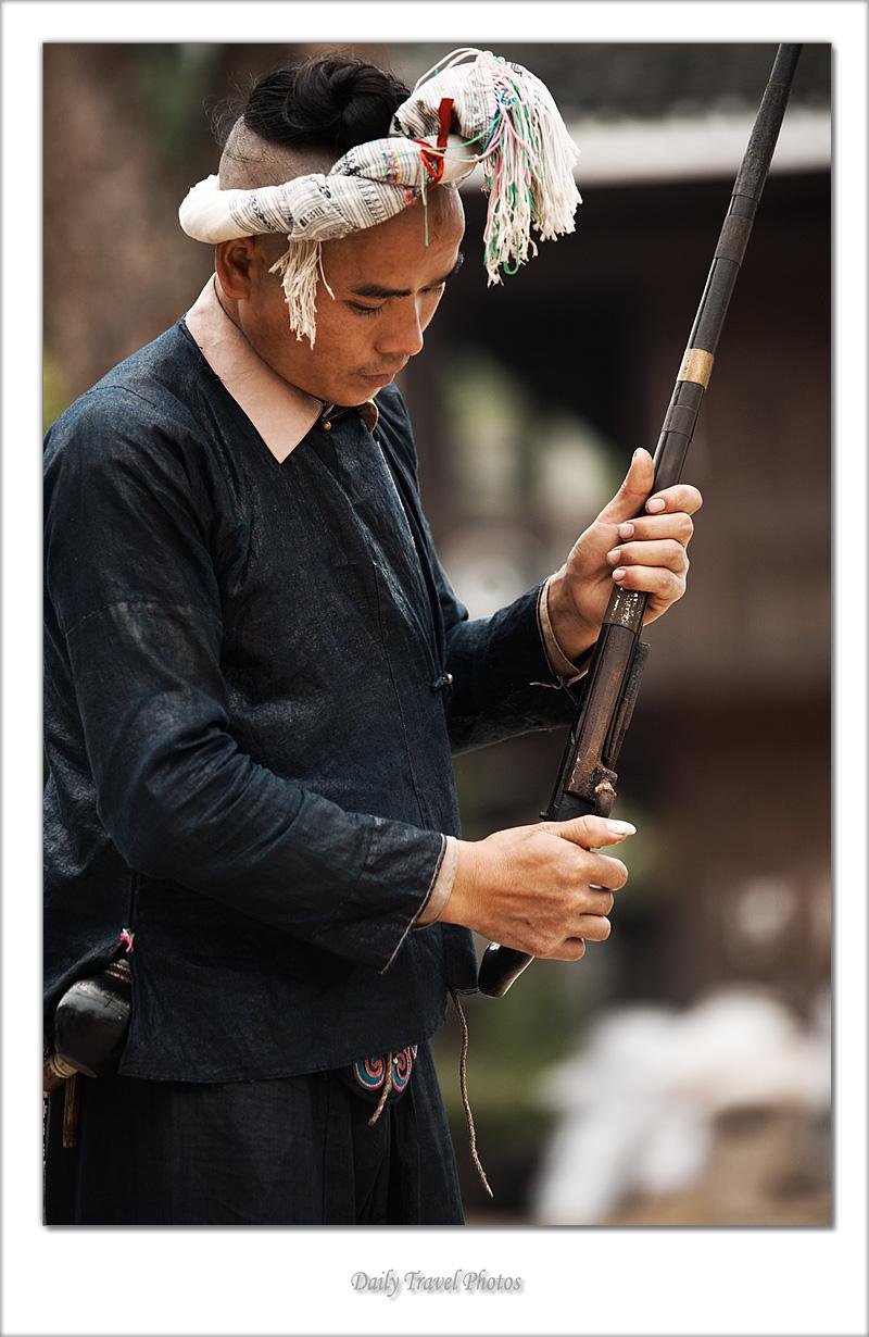 Miao ethnic minority prepares his gun - Biasha, Guizhou, China - Daily Travel Photos