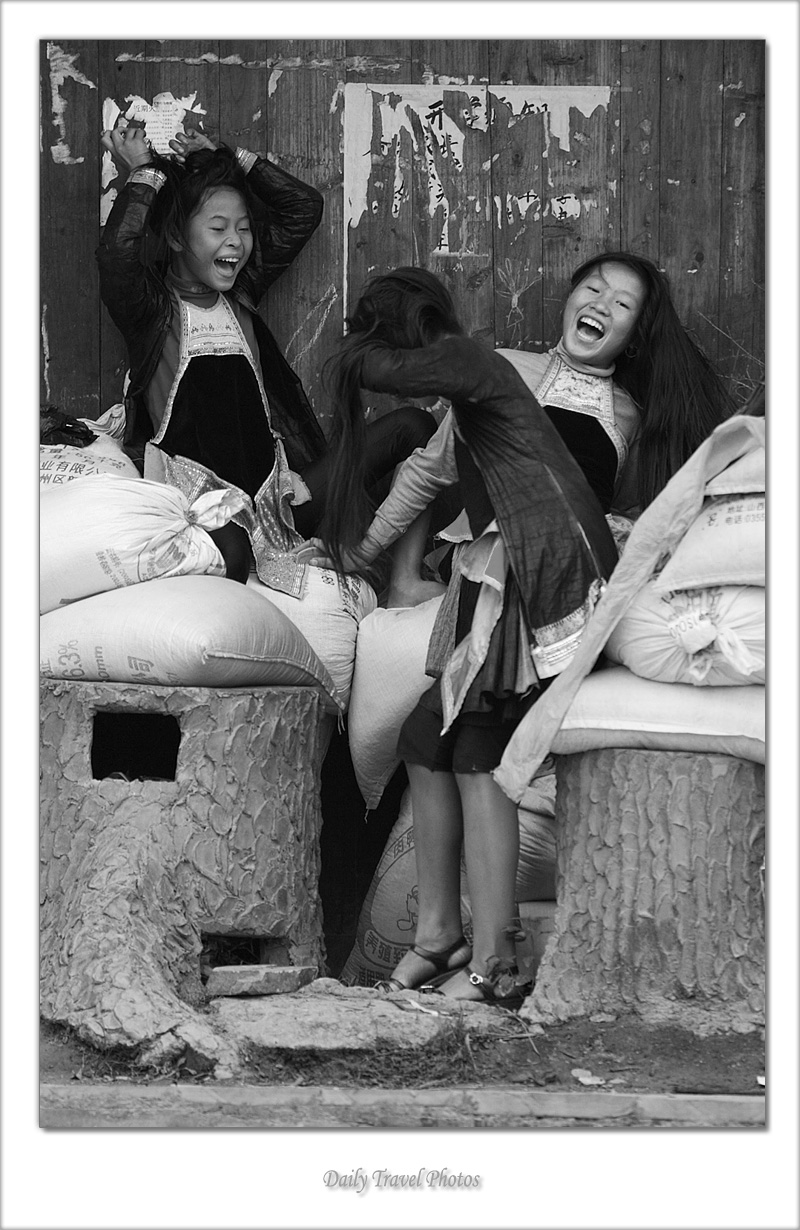 Miao ethnic minority girls laughing - Biasha, Guizhou, China - Daily Travel Photos