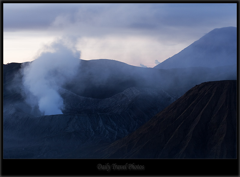 Three cones billow smoke from the active volcanoes at Gunung Bromo National Park - Mt. Bromo, Java, Indonesia - Daily Travel Photos