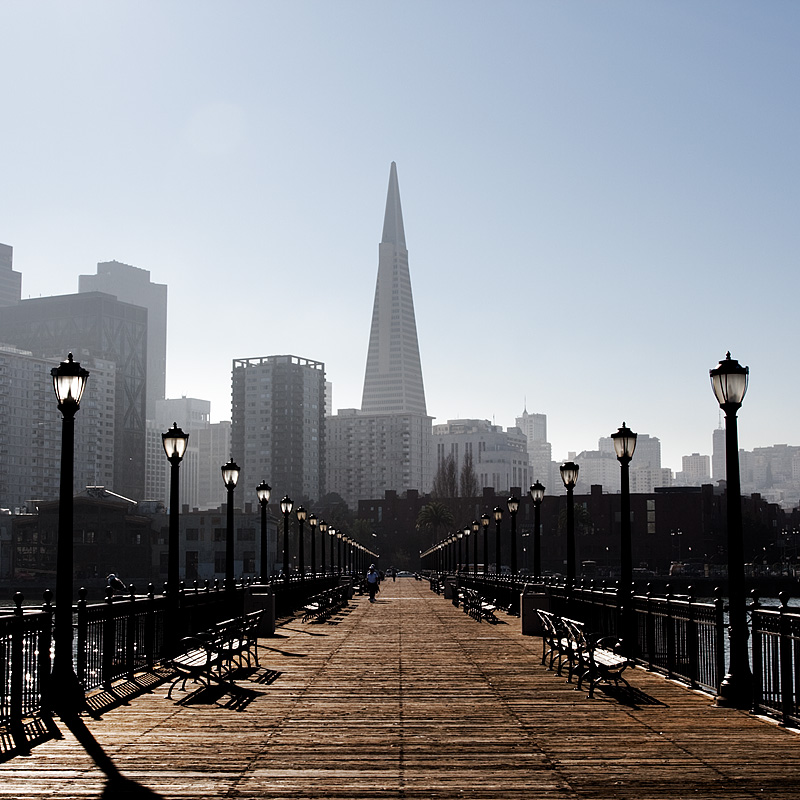 A pier on the bay leads to the Transamerica building in the financial district of downtown - San Francisco, California, USA - Daily Travel Photos