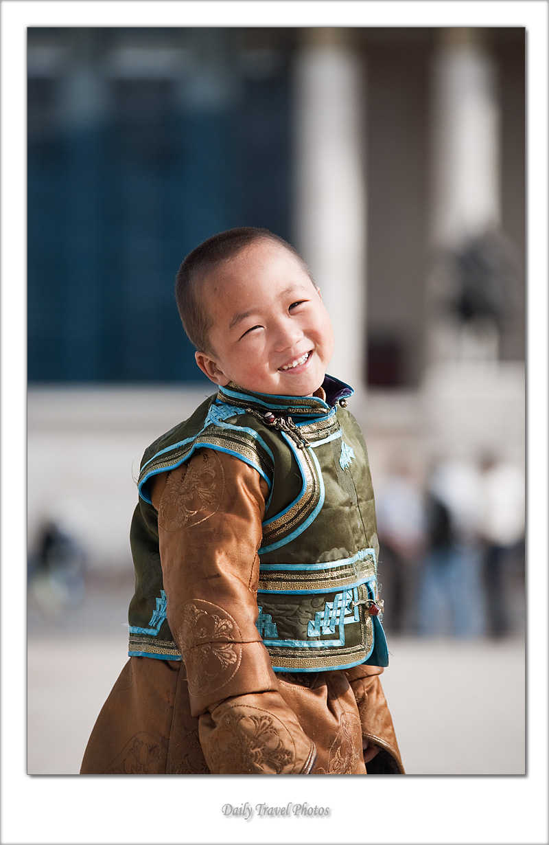 Young Mongolian boy smiles in traditional clothes - Ulaan Baatar, Mongolia - Daily Travel Photos